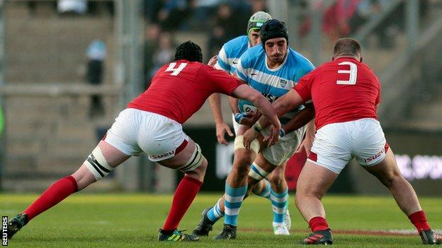 "Argentina's Tomas Lavanini is stopped by Wales"" Adam Beard (4) and Dillon Lewis"