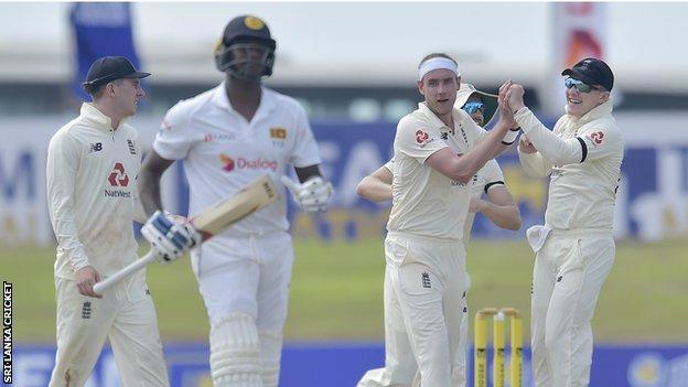 Stuart Broad celebrates wicket of Angelo Matthews