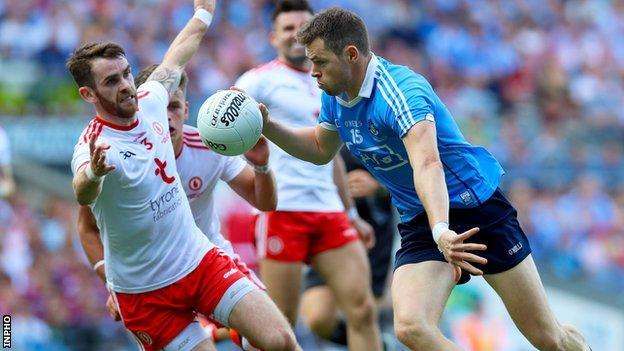 Tyrone's Ronan McNamee attempts to halt the progress of Dublin's Dean Rock