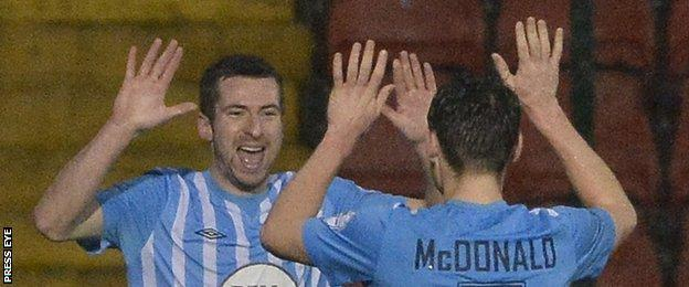 Stephen Murray celebrates with Conor McDonald after hitting Warrenpoint's equaliser at Solitude