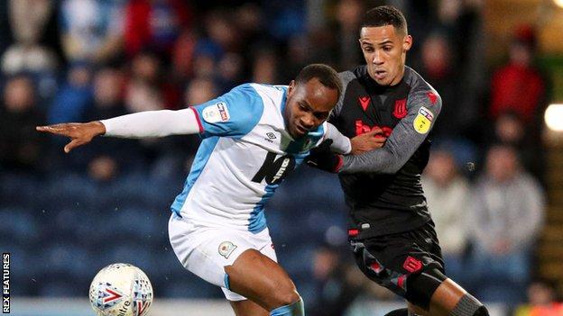 Blackburn full-back Ryan Nyambe (left)