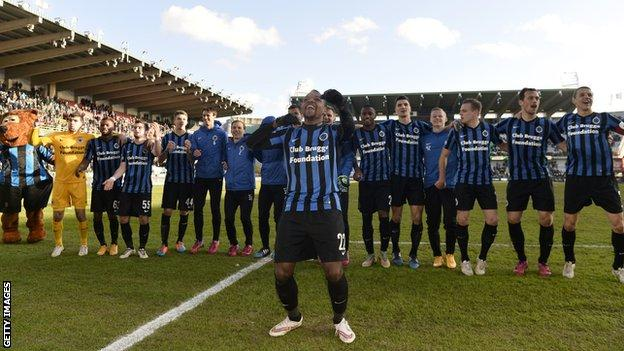 Jose Izquierdo leads celebrations for Club Brugge following victory over Royal Mouscron-Peruwelz