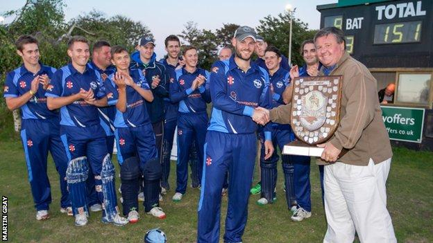 Cobo captain Jamie Nussbaumer gets the Rozel Shield from his father, GCB chairman Dave Nussbaumer