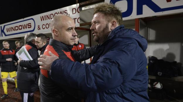 Cliftonville manager Gerard Lyttle with Ards counterpart Niall Currie after watching his side secure the first trophy of his tenure at the Solitude club