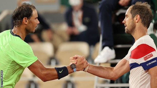 Rafael Nadal and Richard Gasquet shake hands at the net after their French Open match