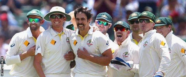 Mitchell Johnson (centre) celebrates with team-mates
