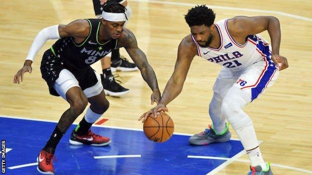 Jarred Vanderbilt of the Minnesota Timberwolves tries to steal the ball from Joel Embiid