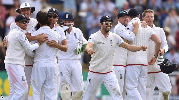 England players celebrate victory in Cardiff