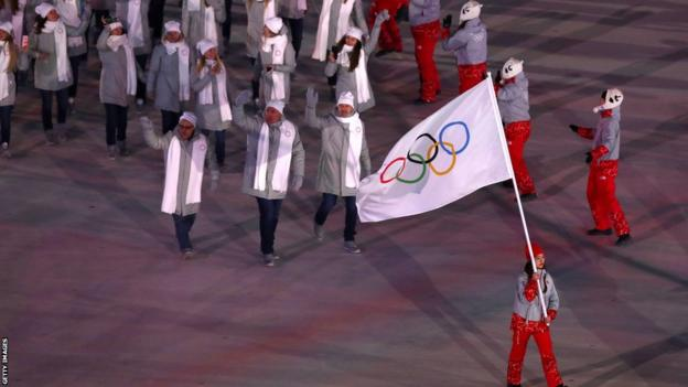 Russian walk out under the Olympic flag