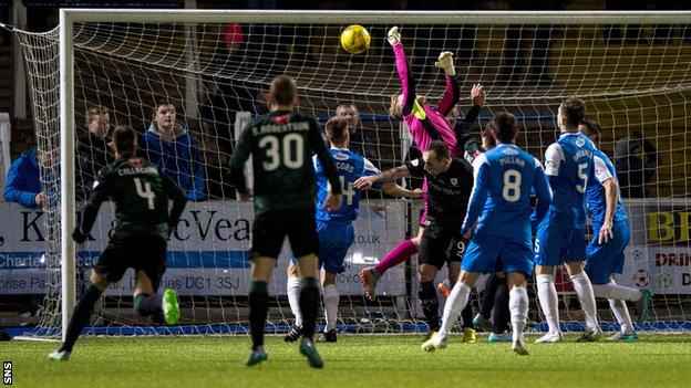 Robbie Thomson cannot hold Lewis Toshney's cross