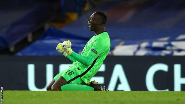 Senegal and Chelsea goalkeeper Edouard Mendy celebrates reaching the European Champions League final