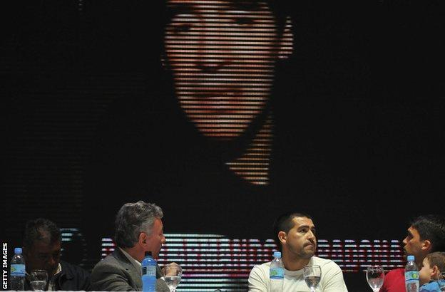 Diego Maradona addresses a press conference by video link