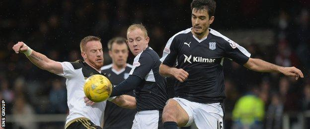 Dundee struggled to contain Aberdeen at a blustery Dens Park