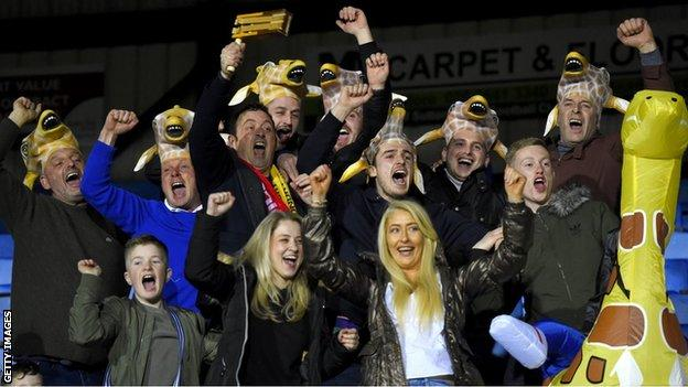 Sutton United fans enjoy the pre-match atmosphere