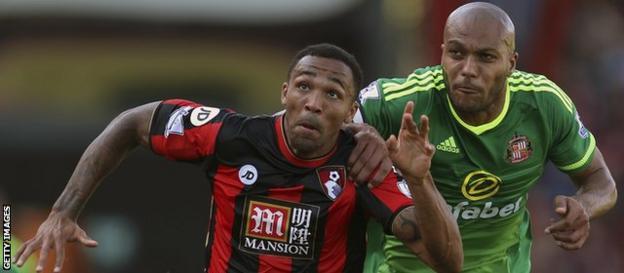 Bournemouth striker Callum Wilson evades Sunderland defender Younes Kaboul