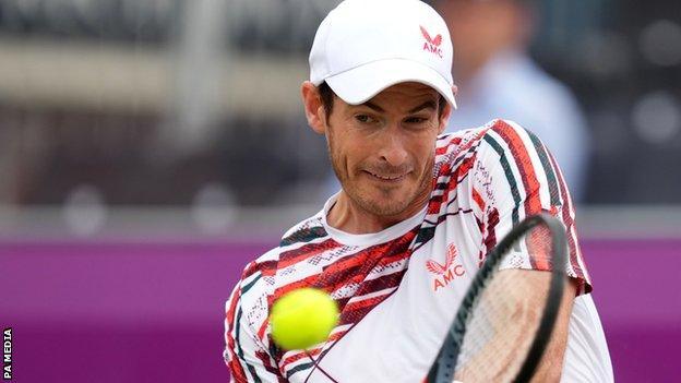 Andy Murray returns against Matteo Berrettini at Queen's