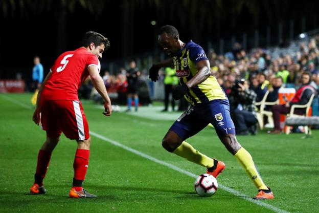 Jamaican sprinting great Usain Bolt makes his debut in professional football for the Central Coast Mariners