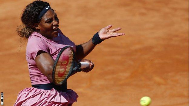 Serena Williams returns a ball