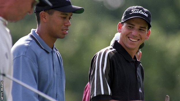 Tiger Woods and Sergio Garcia, talking as they walk up fairway