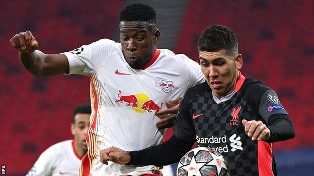 Liverpool's Roberto Firmino challenges Nordi Mukiele
