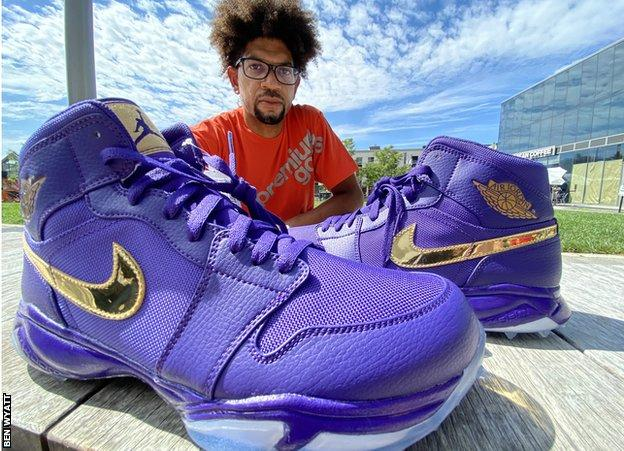 Chad Jones poses with his sneakers
