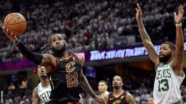 Boston Celtics' Marcus Morris attempts to block LeBron James of Cleveland Cavaliers