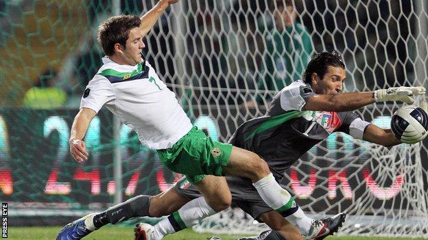 Andrew Little in action for NI against legendary Italian goalkeeper Gianluigi Buffon in October 2011
