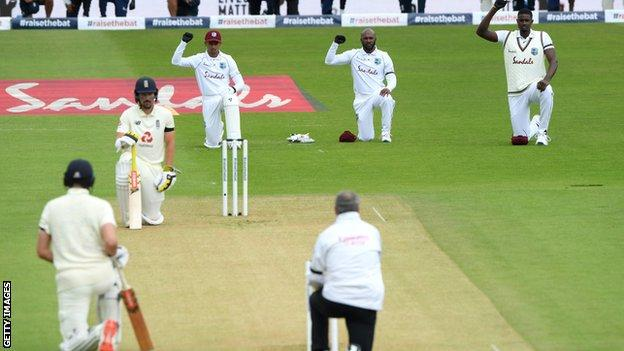 England and West Indies players take a knee