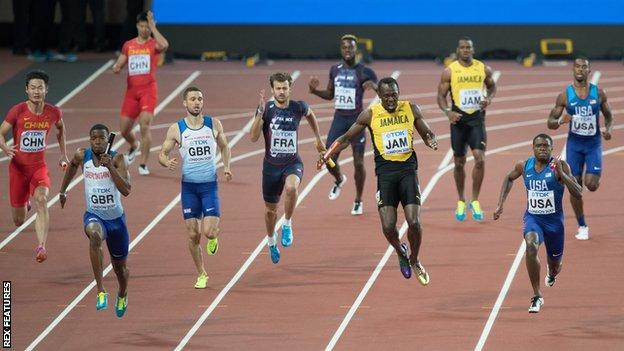 Usain Bolt (fourth from right) pulls up