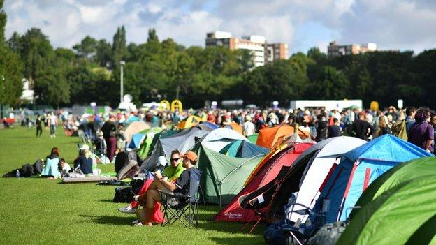 A general view of tents and people queuing on day one of Wimbledon 2019