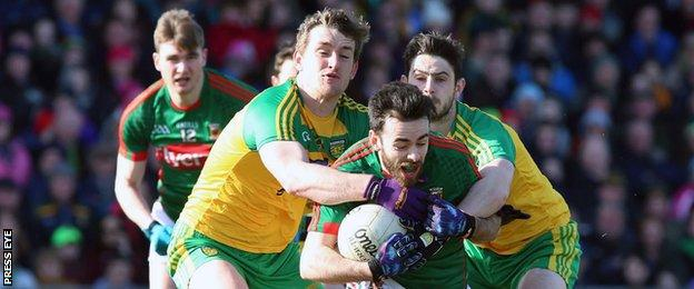 Donegal duo Hugh McFadden and Ryan McHugh challenge Mayo's Kevin McLaughlin