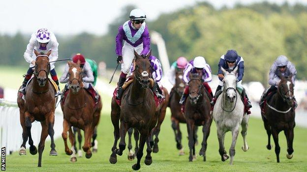 Alcohol Free and Oisin Murphy (centre) coming home to win the Qatar Sussex Stakes