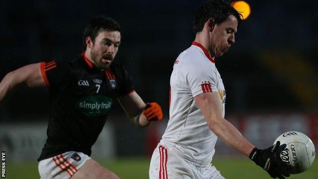 Tyrone's Mattie Donnelly attempts to burst away from Armagh's Aidan Forker