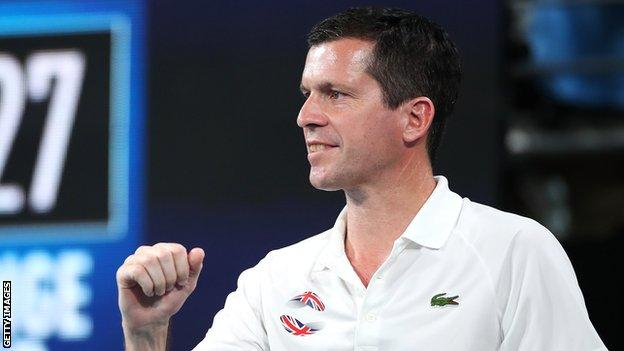 Britain captain Tim Henman cheers on Cameron Norrie