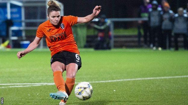 Jo Love scores the winning penalty against Brondby