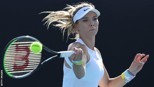 Katie Boulter hitting a return during her Australian Open match against Elina Svitolina