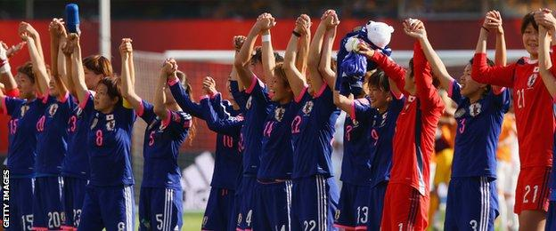 Japan players celebrate