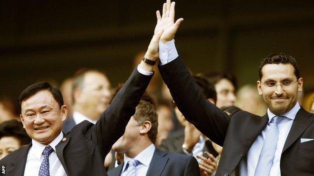 Manchester City's Thai owner Thaksin Shinawatra (left) stands with new chairman designate Khaldoon Al Mubarak