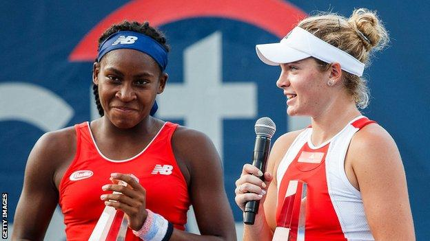 American teenagers Coco Gauff (left) and Catherine McNally celebrate winning the women's doubles at the Washington Open