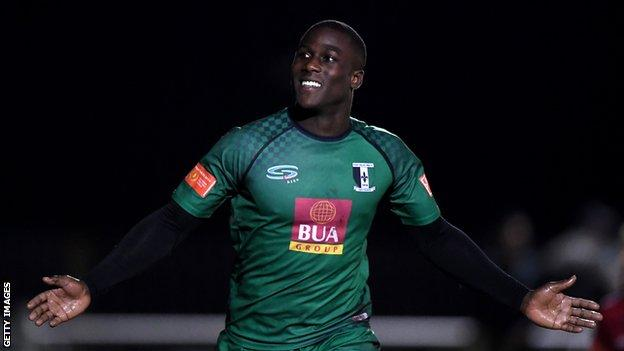 Ade Yusuff of Cray Valley Paper Mills celebrates scoring his side's second goal during the FA Cup Third Qualifying Round match between Cray Valley Paper Mills and Aveley