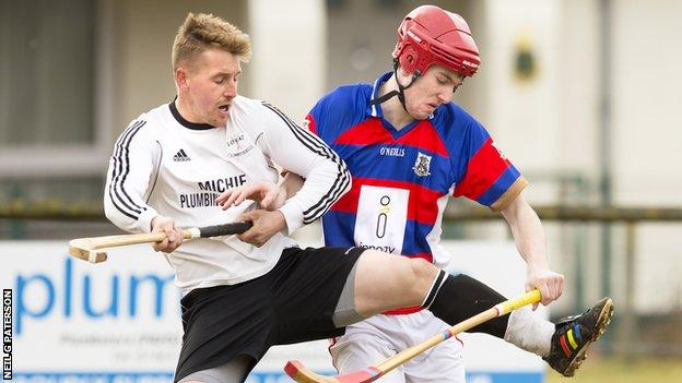 Lovat and Kingussie players contest possession
