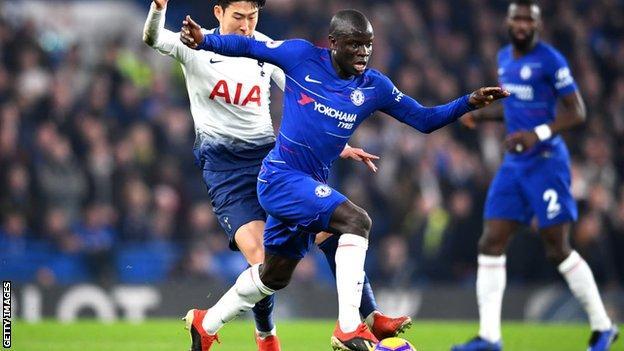 N'Golo Kante runs with the ball