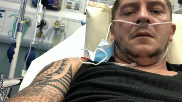 Chester joint manager Anthony Johnson lies in a hospital bed after testing positive for coronavirus