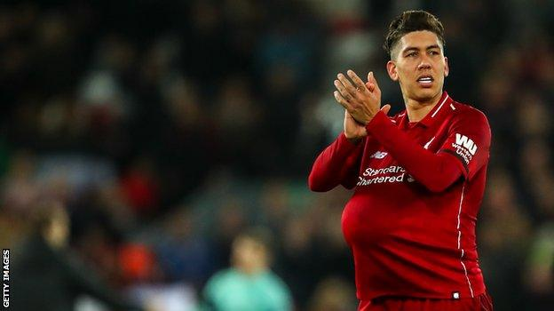 Liverpool striker Roberto Firmino celebrates his hat-trick against Arsenal