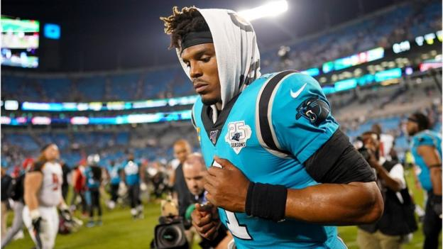 Cam Newton: Carolina Panthers quarterback out for season with foot injury thumbnail
