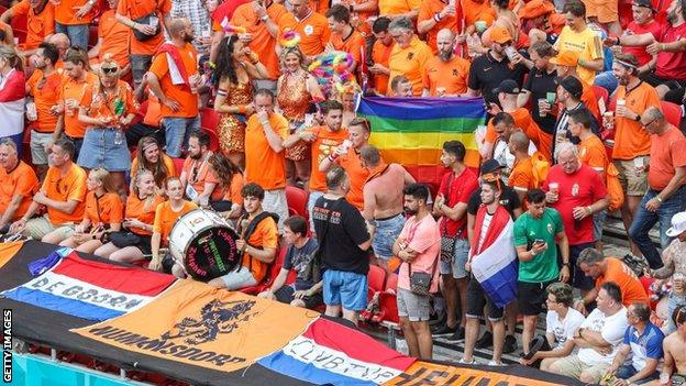 Netherlands fans with a rainbow flag