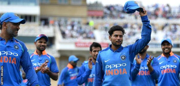 Kuldeep Yadav is applauded off the field after taking 6-25 for India