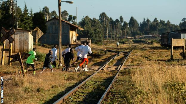 Kipchoge and fellow training partners out running