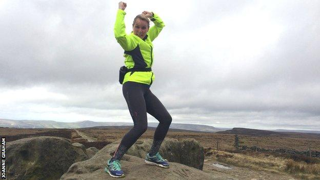 Joanne Graham at Stanage Pole in the Peak District during a London Marathon training run
