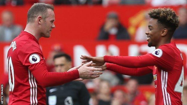 Wayne Rooney and Angel Gomes